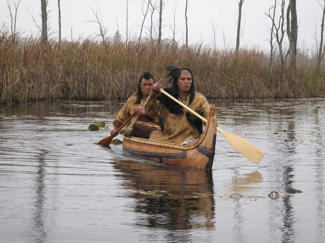 "In this scene, we're showing the ""axe"" traversing great distances. The birchbark canoe is authentic."
